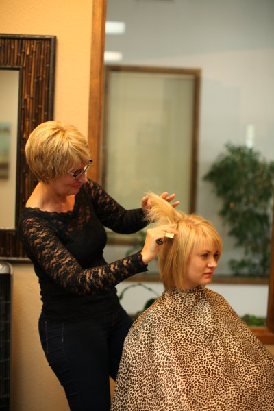 Salon 525 giving hair cut and color